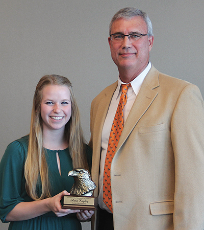 Anna Kegley receives Tylor Duke Scholarship from Tylor's father, Stan Duke at the Annual BCMB Award Reception.