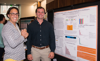 Reid Kelly, REU student from Gallaudet University, with Gladys Alexandre at the campus-wide summer undergraduate STEM poster symposium.