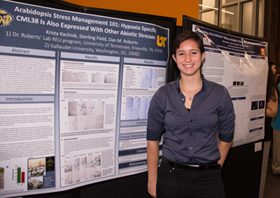 Krista Kachnik, REU student from Gallaudet University, presents her work at the campus-wide summer undergraduate STEM poster symposium.